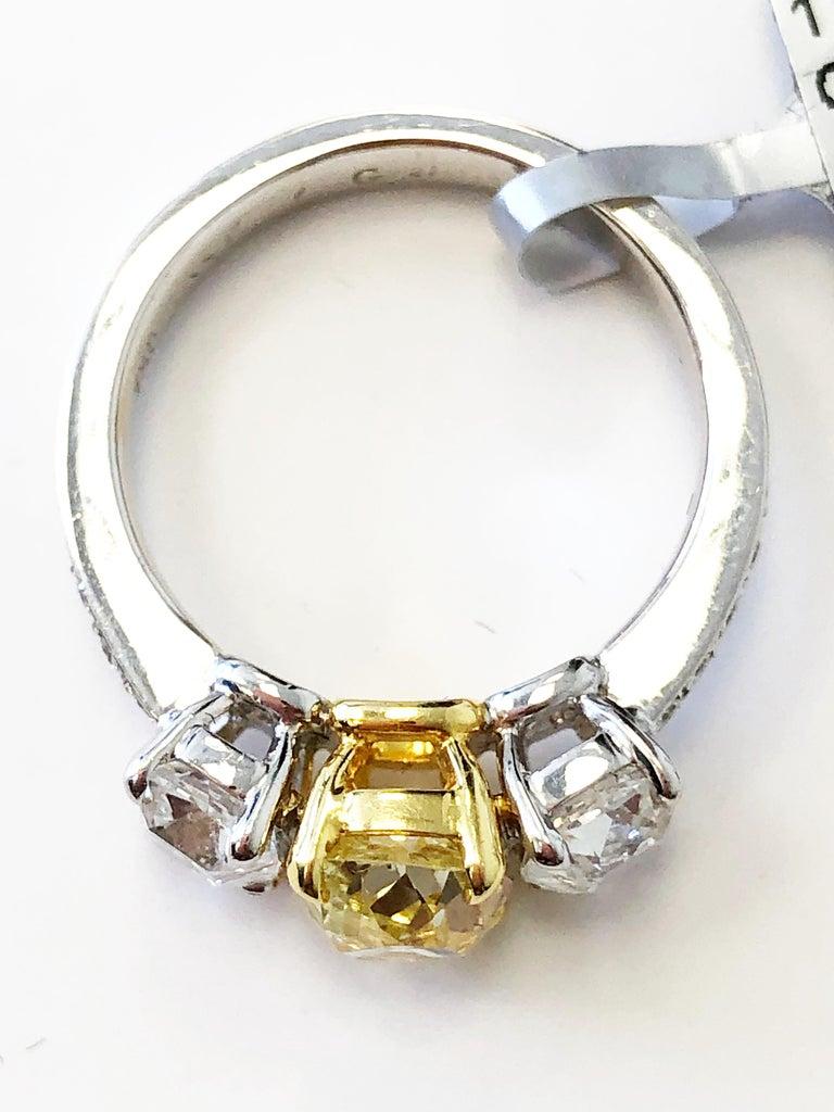 Cushion Cut GIA Fancy Yellow Diamond Cushion and White Diamond 3 Stone Ring in 18k Gold