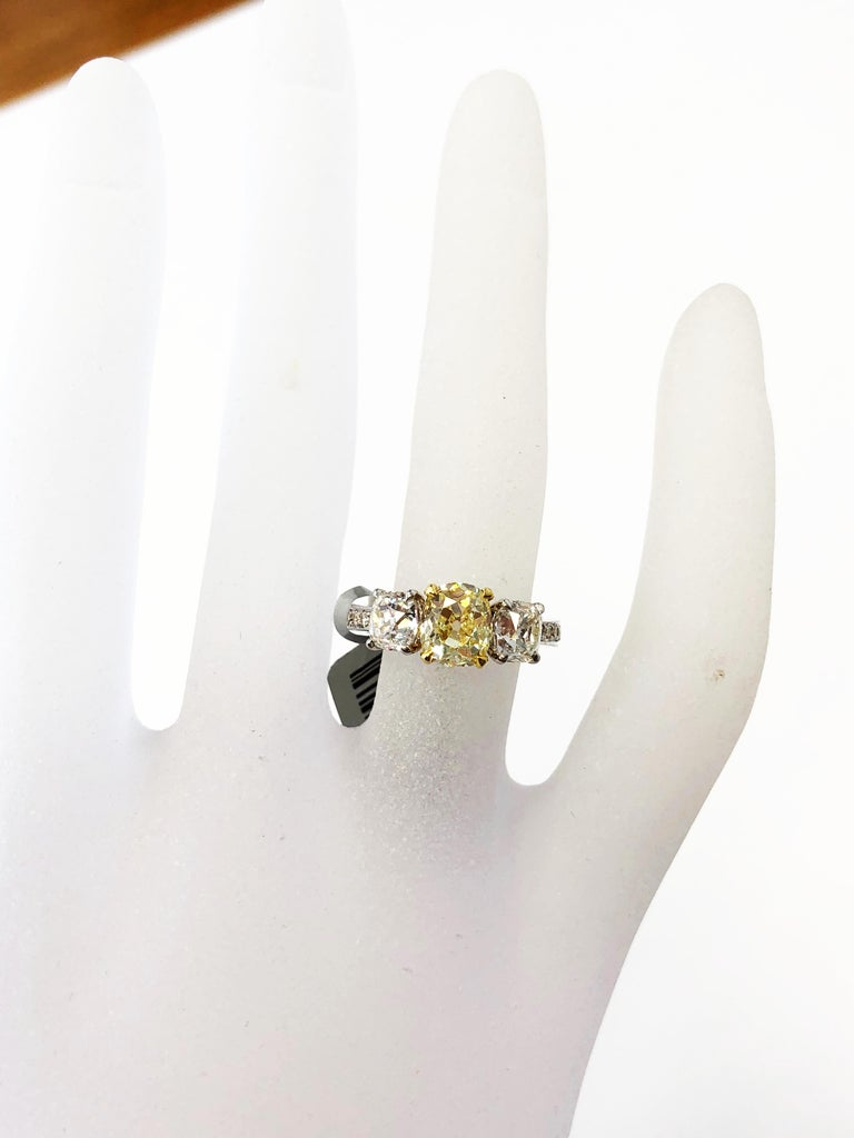 GIA Fancy Yellow Diamond Cushion and White Diamond 3 Stone Ring in 18k Gold  In New Condition In Los Angeles, CA