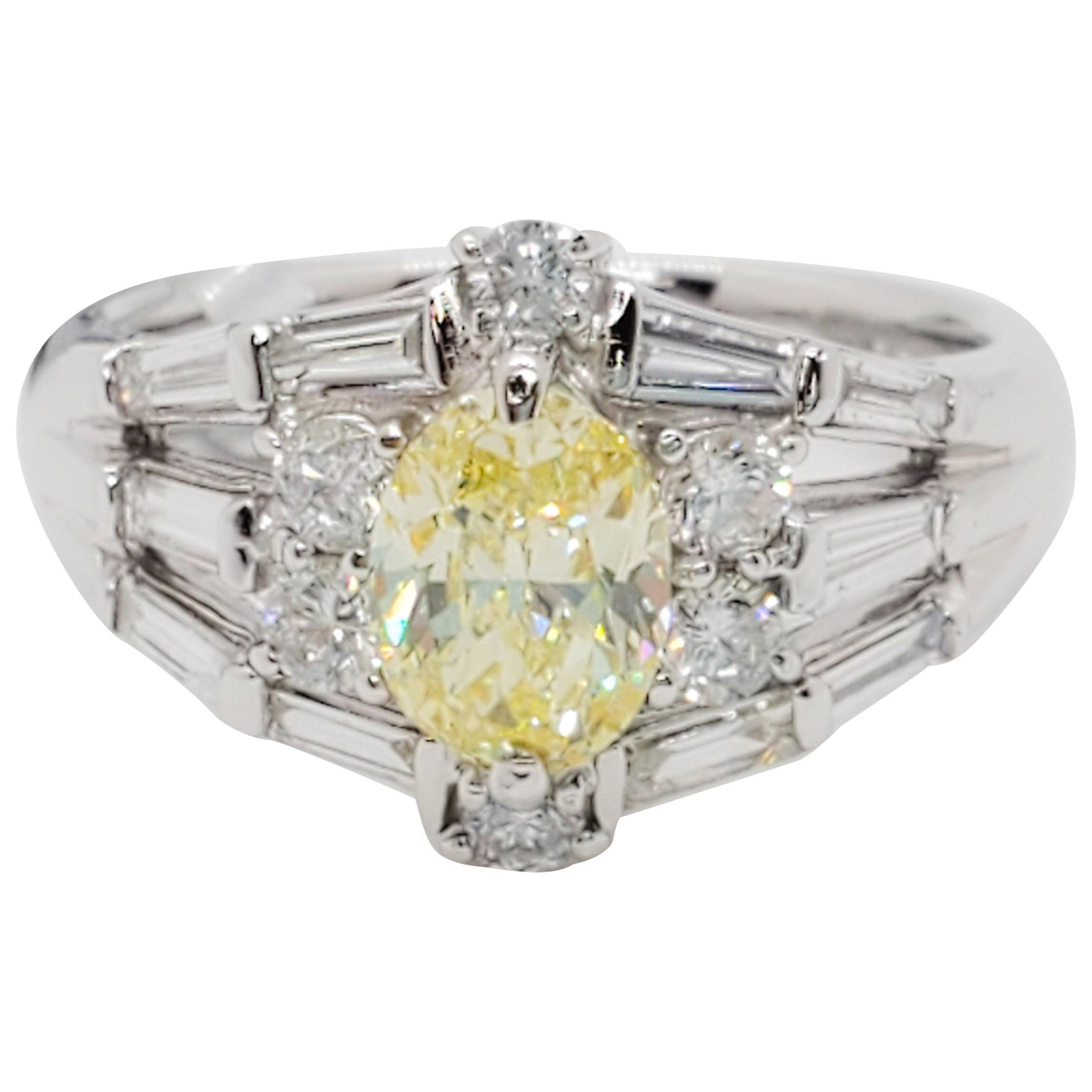 GIA Fancy Yellow Diamond Oval and White Diamond Platinum Ring