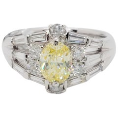GIA Fancy Yellow Diamond Oval and White Diamond Platinum Ring