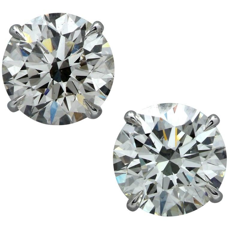 GIA Graded 6.14 Carat Brilliant Cut Diamond Solitaire Stud Earrings