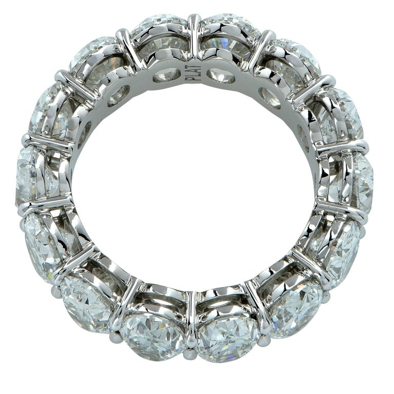 Spectacular eternity band crafted by hand in Platinum showcasing 14 stunning GIA certified Oval Brilliant cut diamonds weighing 9.92 carats total, F-G color, VS2-SI1 clarity. Each diamond is laser inscribed with the GIA report number. The diamonds