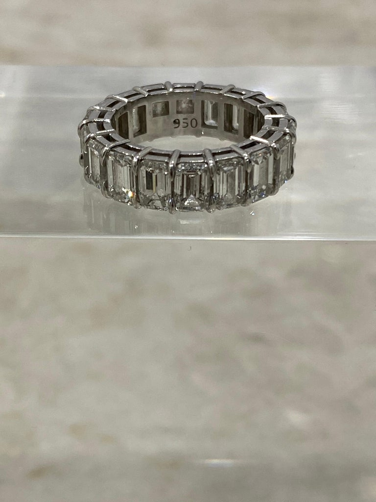 If your looking for a quality, classic eternity band to cherish for years to come.... 18 emerald cut diamonds set in a custom platinum 2 shared prong setting. Many diamonds have GIA inscriptions on girdle of diamond. Visible with jewelers