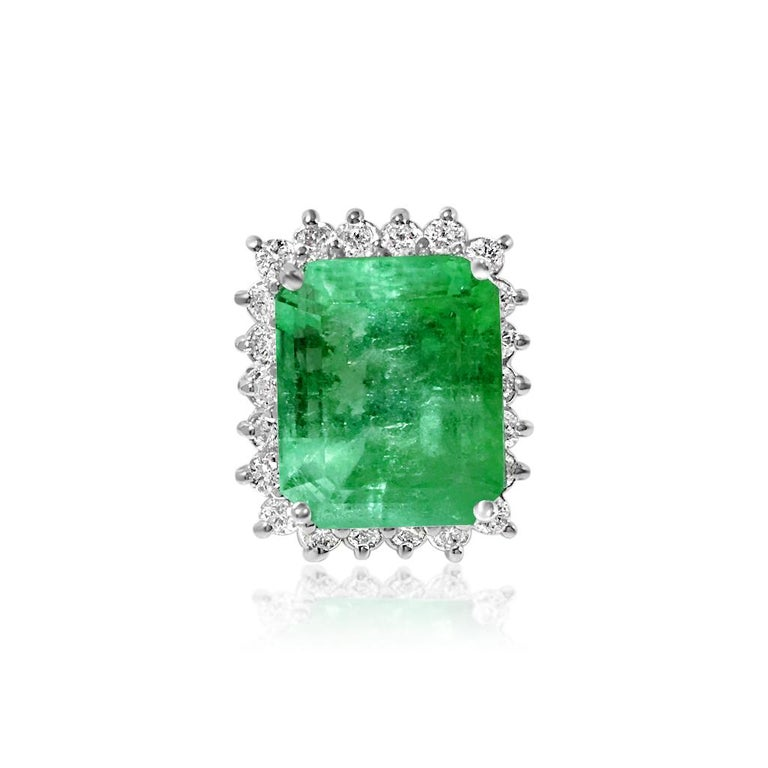 Metal: 14k white gold.   20.00 carats emerald. 100% natural earth mined emerald. Origin: Colombian. Cut: Emerald shape. Prong setting. Deep luster and shine. Great saturation and color.   Diamond: 2.20 carats total. Round brilliant cut. F color, VS