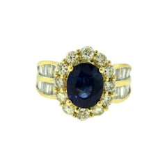 GIA Natural Corundum Sapphire, Round and Baguette Diamond Yellow Gold Ring
