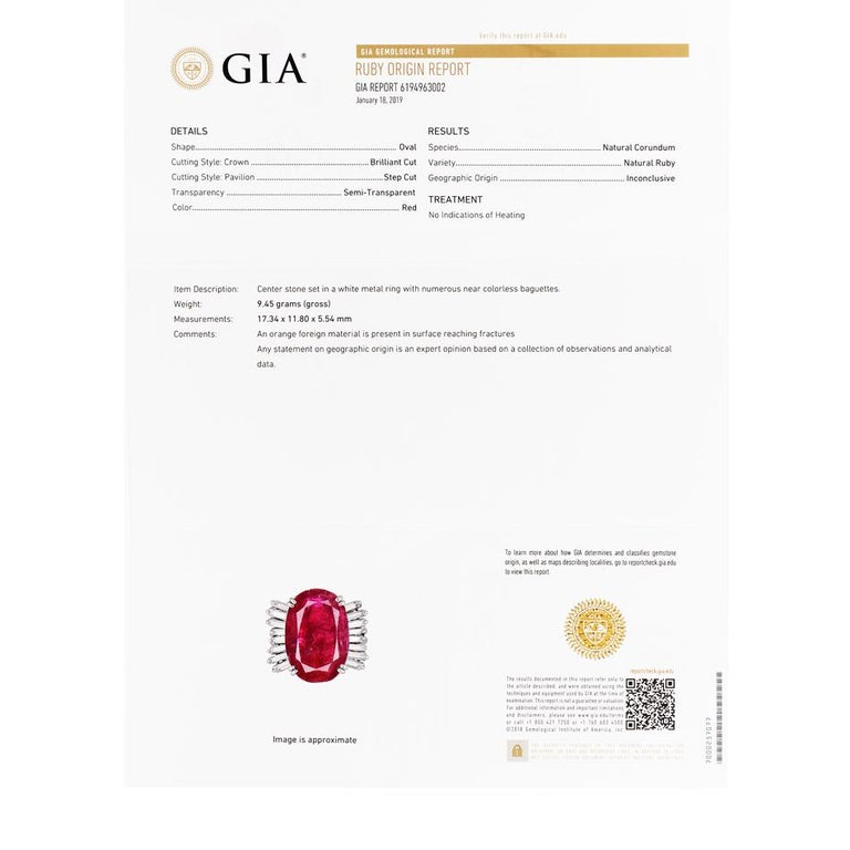 This chic ruby and diamond cocktail ring is crafted in solid platinum, weighing 9.2 grams and 17mm x 9mm high. Showcasing a prominent GIA lab reported oval shaped, prong-set red ruby with no indications of heating, weighing approximately, 9.10