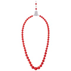 GIA Oxblood Coral Strand and 3.95 Carat Diamond and Platinum Clasp