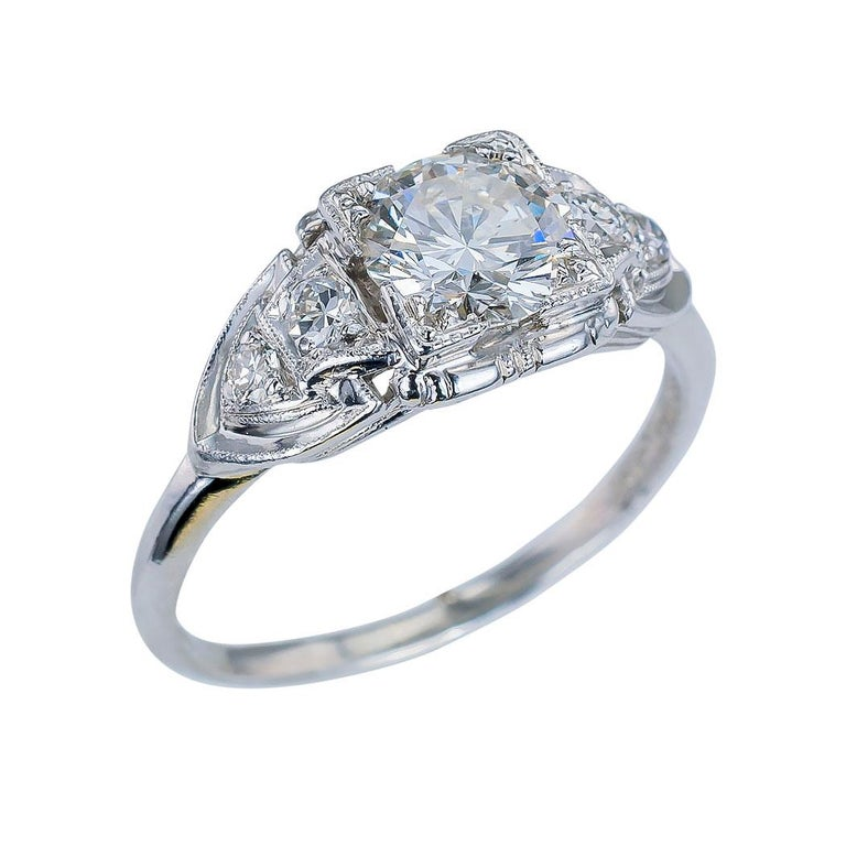 GIA report certified 0.83 carat F color round brilliant cut diamond solitaire engagement ring in a platinum mounting circa 1930 ring size 6 ¼.  This is a fine diamond engagement ring with which you can impress that special lady in your life by
