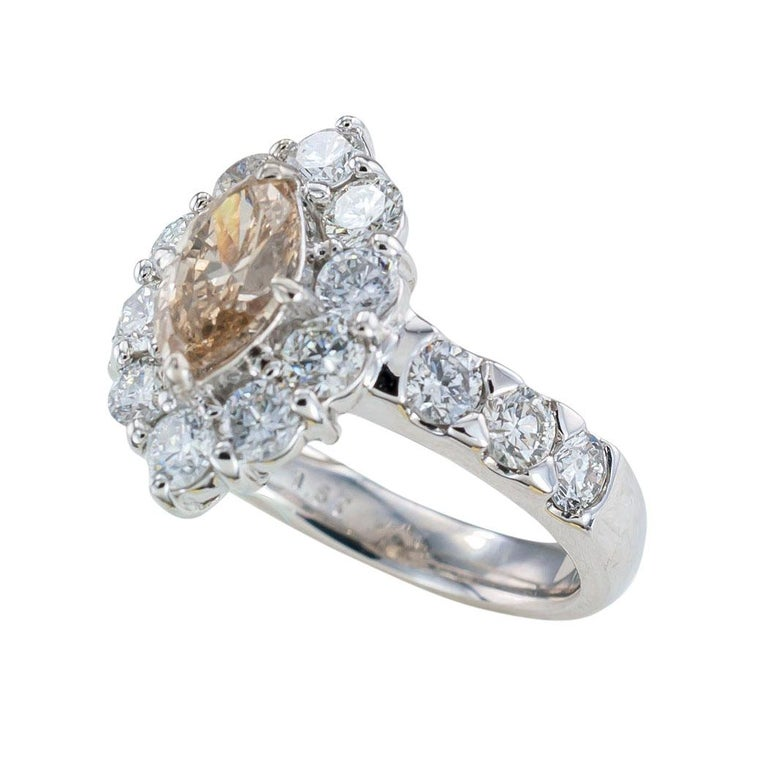 GIA report certified 0.88 carat light brown marquise diamond and platinum engagement ring circa 1990.  It is time to pop the question and present that special lady in your life with this beautiful GIA certified 0.88 carat, light brown marquise