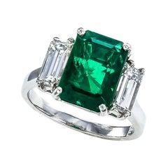 GIA Report Certified 3.98 Carat Emerald Diamond Three Stone Platinum Ring