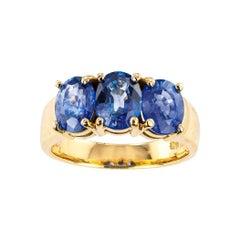GIA Report Certified Ceylon Sapphire Three Stone Yellow Gold Ring