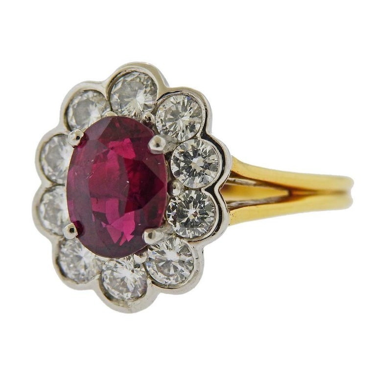 18k gold and platinum ring. Set with GIA certified ruby - 9.28 x 7.08 x 5.04mm, and diamonds approx. 1.00ctw. Measures - size 6, ring top is 16.4mm wide. Marked 18k Plat. Weight 6.8 grams. Comes with GIA #1176990126.