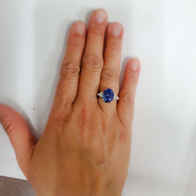 Gorgeous perfect blue unheated blue sapphire oval weighing 5.31 ct. with 0.55 ct. good quality white diamond trillions.  Handcrafted platinum mounting in size 5.5.  Comes with GIA report.