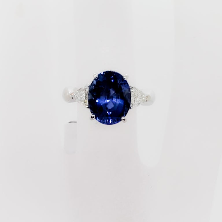 Oval Cut GIA Unheated Blue Sapphire Oval and White Diamond Three-Stone Ring For Sale