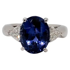 GIA Unheated Blue Sapphire Oval and White Diamond Three-Stone Ring