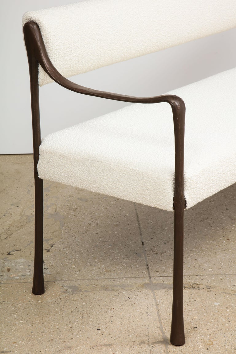 With its sinuous, classical line, the Giac collection is named after Giacometti, its inspiration. The collection provides an elegant and sleek seating option that appears delicate but has incredible gravitas. Shown here in an oil-rubbed bronze