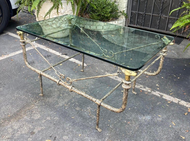 Giacometti style Paul Ferrante wrought iron hound head coffee table.