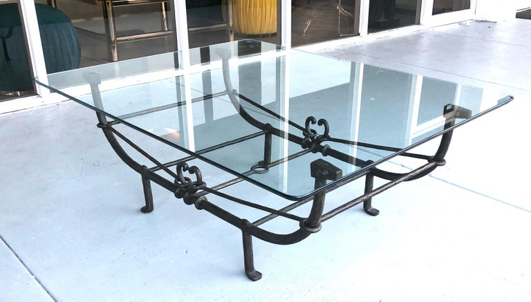 A large coffee table in the style of Giacometti. Steel base with a bronze patina. Nice detail and top craftsmanship. Could hold a larger glass top. Metal base measures 46