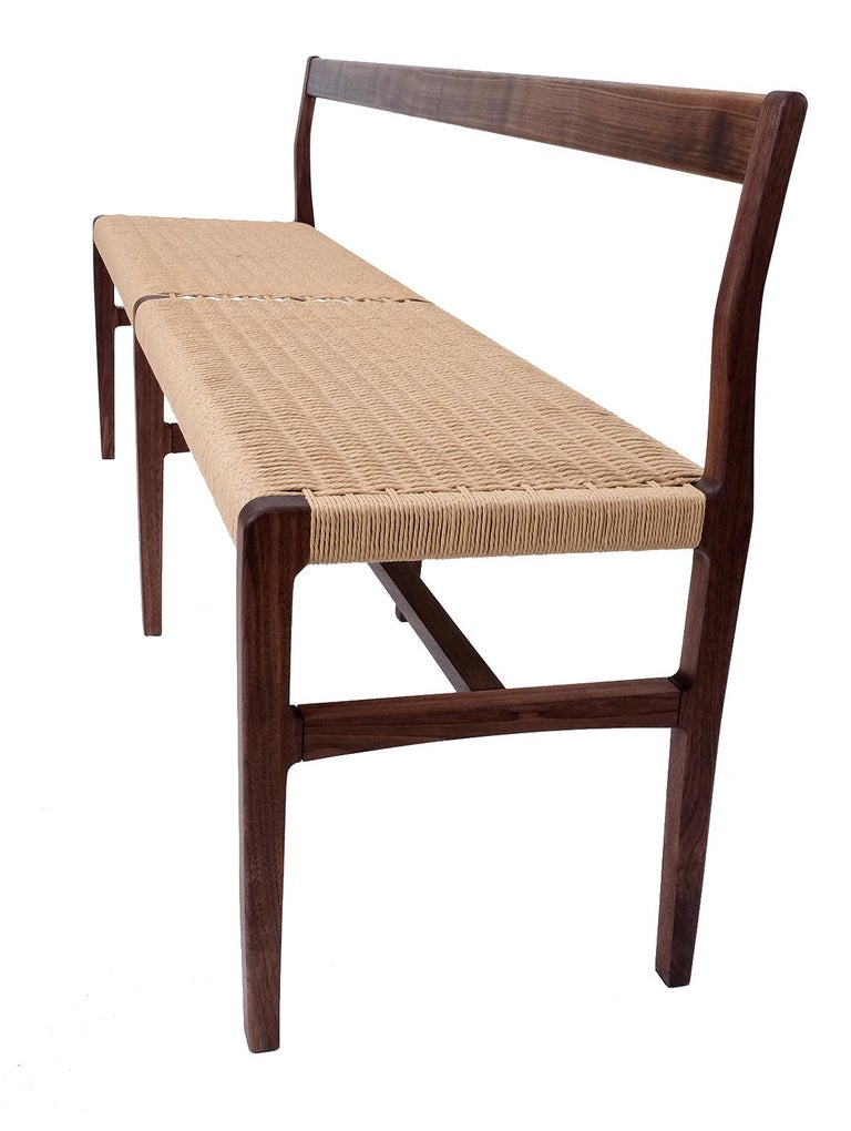 We've added an extra-long version of our bench, with subtle curves and a Danish cord seat, perfect for use in the hallway, foyer, living space or kitchen. Measures:76