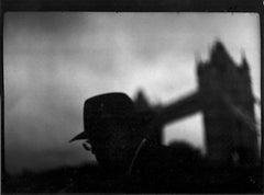 Untitled #5 (Man Glasses Tower Bridge) from Eternal London - Giacomo Brunelli