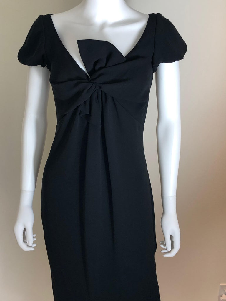 Offered is a signed Giambattista Valli black luxuriously soft sueded silk size 42/S cocktail Dress with plunging neckline and princess sleeve.  The plunging princess neckline is partially covered by a modern half bow and beautifully frames the