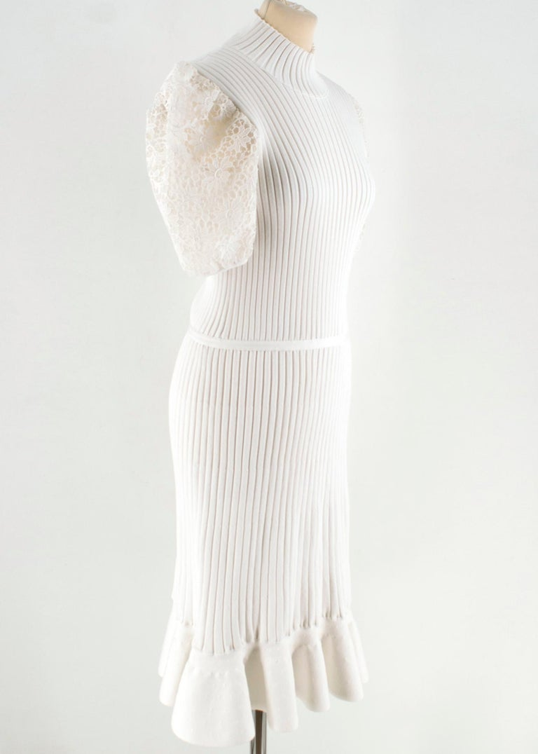 Giambattista Valli Ribbed Lace Sleeve White Dress  Straight Stretch White Dress Peplum Hem Ripped High Neck Laced Puffed Short Sleeves White Hardware  Hidden Zip   Please note, these items are pre-owned and may show some signs of storage, even when
