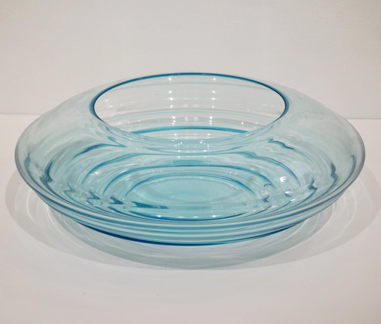 A signed Mid-Century Modern sensual curved centerpiece of great effect, blown in transparent crystal turquoise blue Murano glass, the ridges of the organic modern shape playing with the light create diverse intensities in color. High quality of