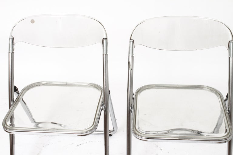 Giancarlo Piretti for Castelli pair of modern acrylic 'Plia' folding chairs. In great vintage condition with some light surface wear, one missing black bracket on front leg.