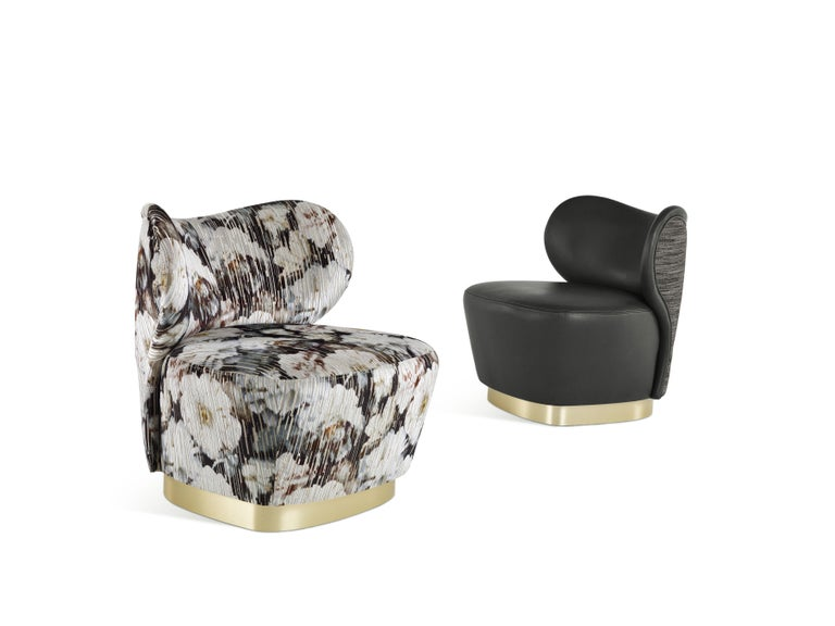 Specifically created for Baglioni Hotel Carlton, this compact armchair with a charming design and essential lines features a metallic base in satin brass and two different upholstery: a special leather with a sought-after teal tone combined with a