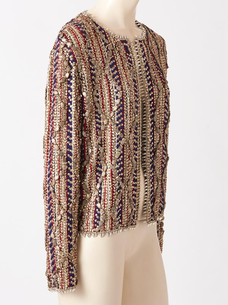 Gianfranco Ferre, evening jacket/cardigan heavily encrusted with beads and embroidery. Composed of silver metallic beading, vertically placed, embellished with large metallic scarab themed beads combined with red and navy vertical embroidery on a
