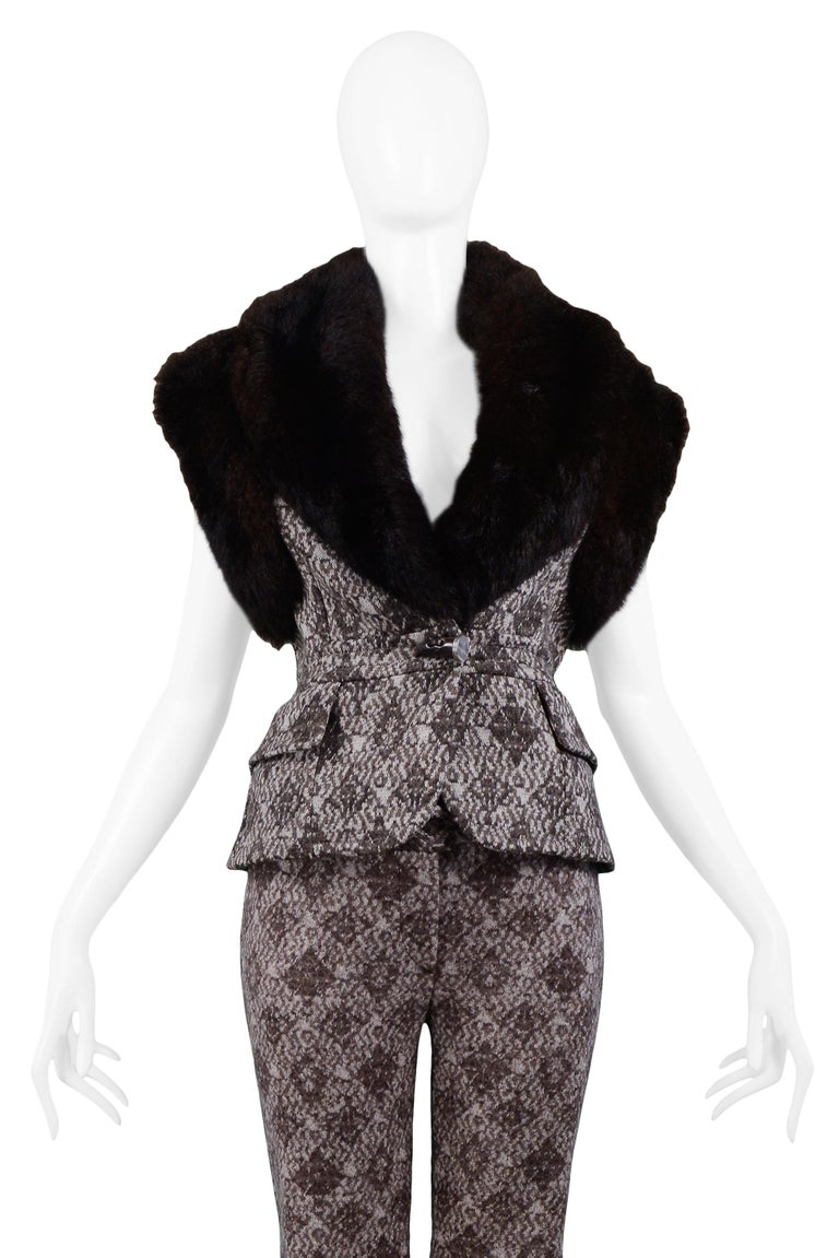 Resurrection Vintage is excited to offer a vintage Gianfranco Ferre brown and cream diamond geometric wool vest and pants ensemble with fur. The vest features a plunging neckline, horn toggle closure at the waist, brown opossum fur at the oversized