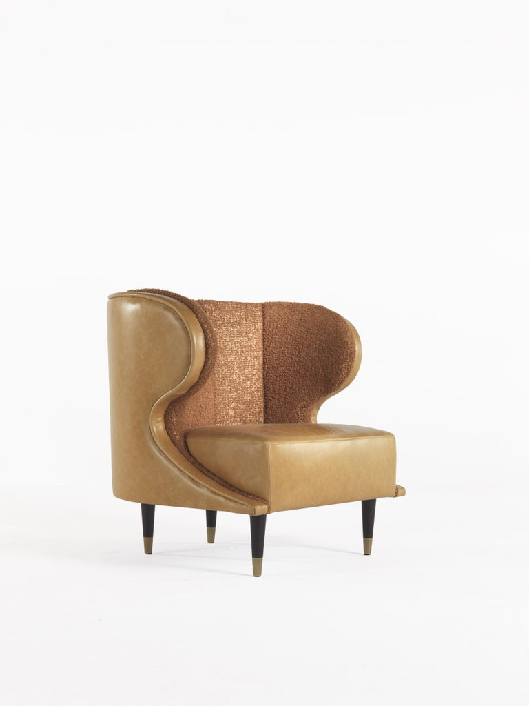 The midcentury charm meets comfort and design in this armchair designed for reading and relaxation, ideal for the sleeping area. Its soft lines and enveloping backrest recall in its shape a classic bergère but with the modern touch of the legs with