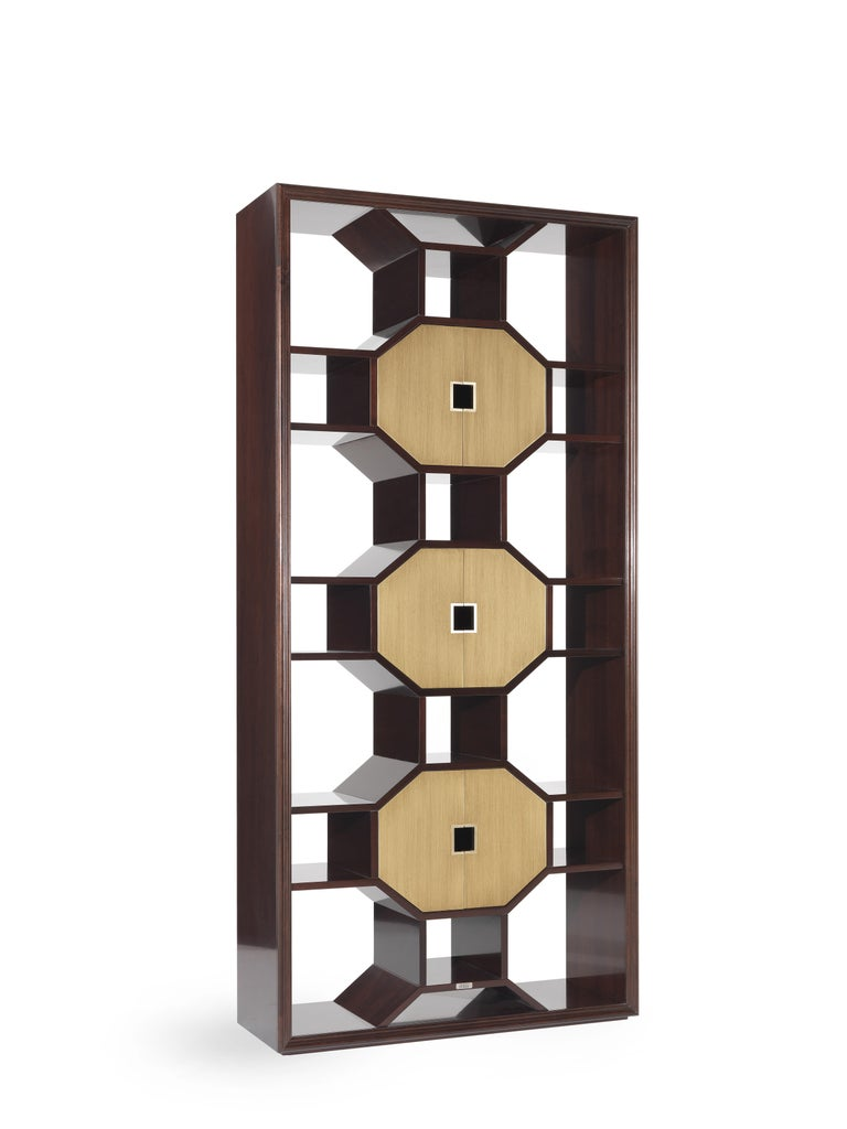 Asian charm embellished with new, precious details. In the eva_1 bookcase, the geometric shapes are exalted by the bronze finish doors, ensuring a captivating and spectacular final result.  The eva_2 bookcase with structure in beech wood. Mahogany