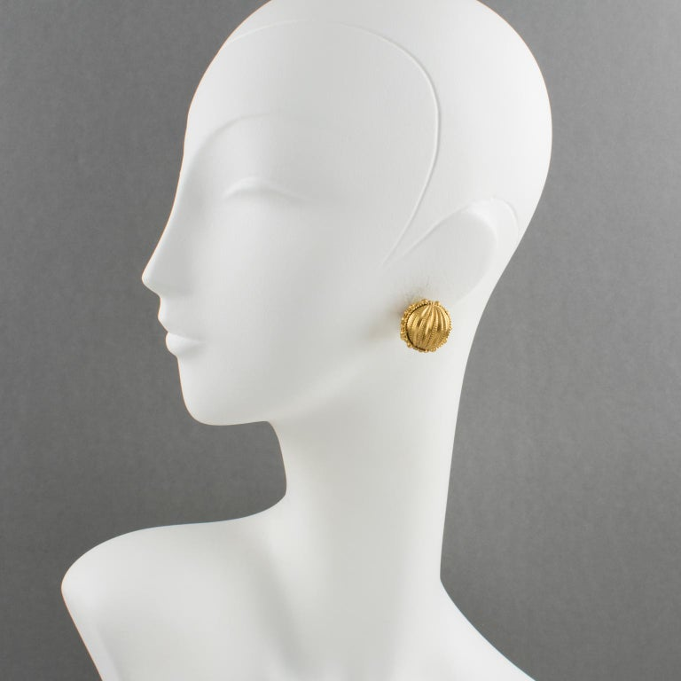 Lovely couture clip-on earrings designed by Gianfranco Ferre, made in Italy. Sphere design with gilt metal all carved and textured. Signed underside: