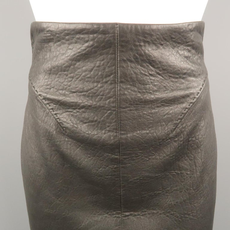 Vintage GIANFRANCO FERRE pencil skirt comes in soft black textured leather with a high rise, darted front, and back cutout with belted waist. Made in Italy.   Excellent Pre-Owned Condition. Marked: IT 40   Measurements:   Waist: 25 in. Hip: 36