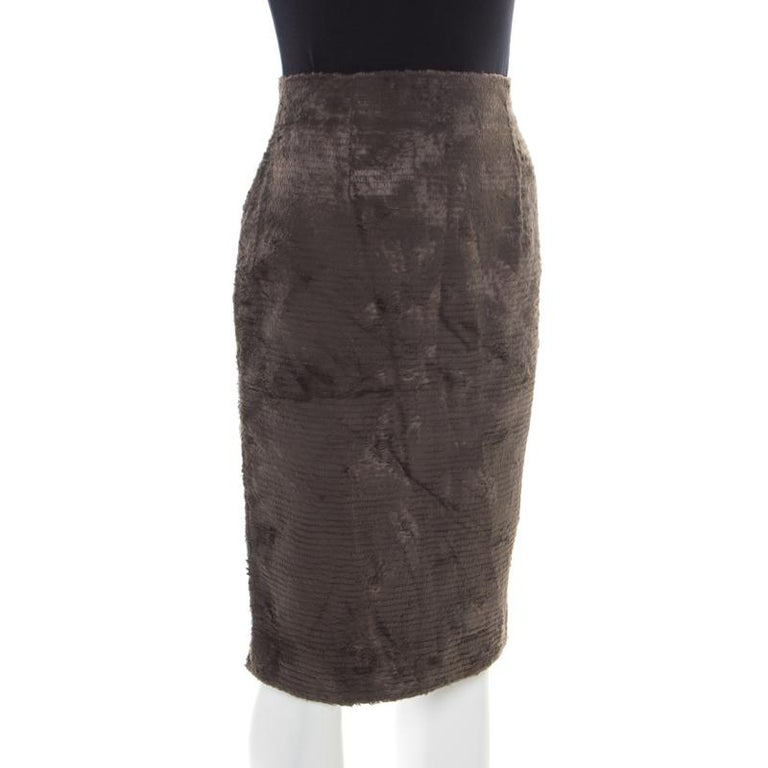 Amaze everyone at the party with your charming style by wearing this Gianfranco Ferre skirt. Tailored from quality fabrics, this textured skirt in vintage grey with a high waistline will offer you a great shape.  Includes: The Luxury Closet