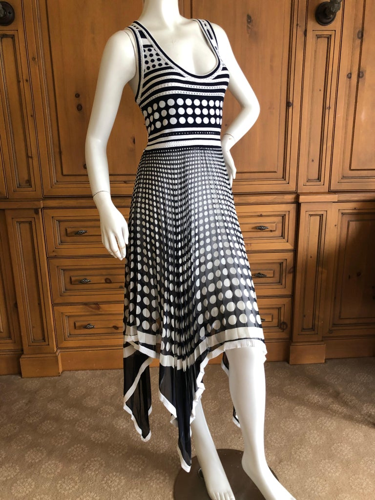Gianfranco Ferre Vintage Op Art Polka Dot Dress with Pleated Asymmetrical Skirt. The top is knit, and the skirt is sheer silk chiffon. Size 44 (Vintage 44 is like today 38) Bust 36