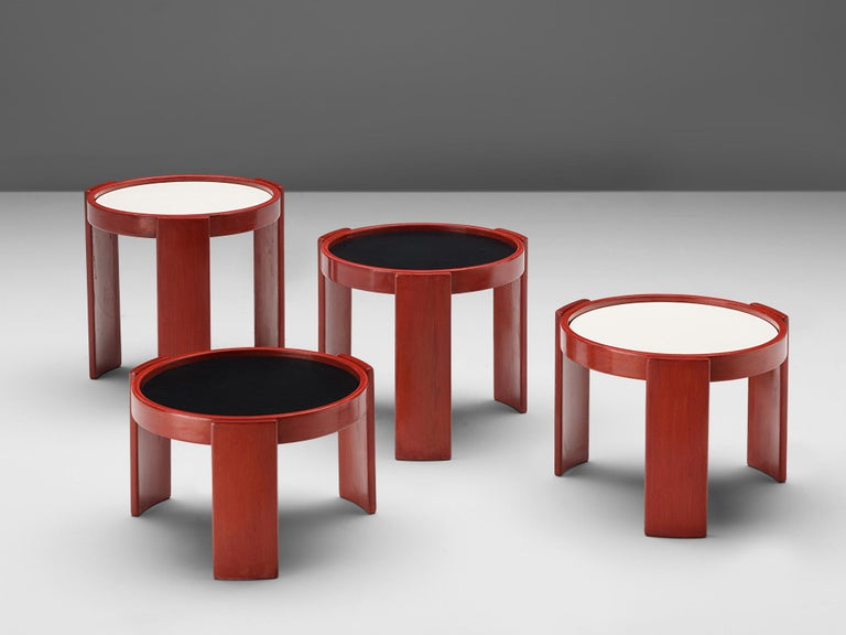 Gianfranco Frattini for Cassina, nesting table, red, black and white lacquered wood, Italy, 1960s.