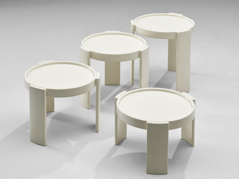 Gianfranco Frattini for Cassina, nesting table, white lacquered wood, Italy, 1960s  Nesting tables, consists of four pieces, designed by Gianfranco Frattini for Cassina. All the tables are white lacquered wood, round shaped and different heights,