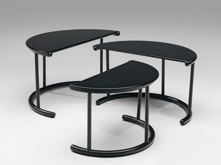 Gianfranco Frattini for Acerbis, set of three 'Tria' nesting tables, metal, Italy, 1980s  A set of three nesting tables by the Italian designer Gianfranco Frattini. Each table consists of a semi-circled tabletop in black-coated metal. The top is