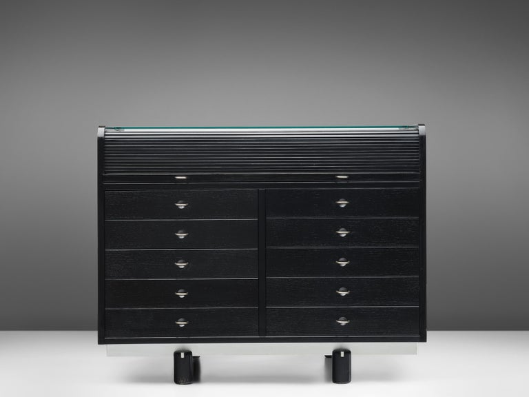 Gianfranco Frattini for Bernini, cabinet with desk model 804, lacquered wood, glass, suede, metal, Italy, 1960s  This black cabinet with integrated desk is designed by Gianfranco Frattini for Bernini. This versatile piece fulfills storage needs as