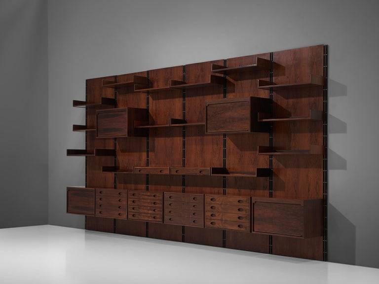 Gianfranco Frattini for Bernini, wall unit, rosewood, Italy, 1960s  This large 4.8mt/15.7ft wall unit is designed by the Italian designer Gianfranco Frattini. The cabinet consists of six panels with various different storage facilities. There are