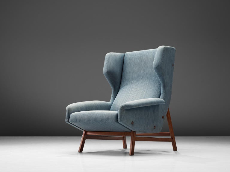 Gianfranco Frattini for Cassina, lounge chair model 877, blu fabric and teak, Italy, circa 1959.  Sturdy and voluminous lounge chair in blue original fabric. This wingback chair shows nice details and elegant lines. The buttons on the outside of