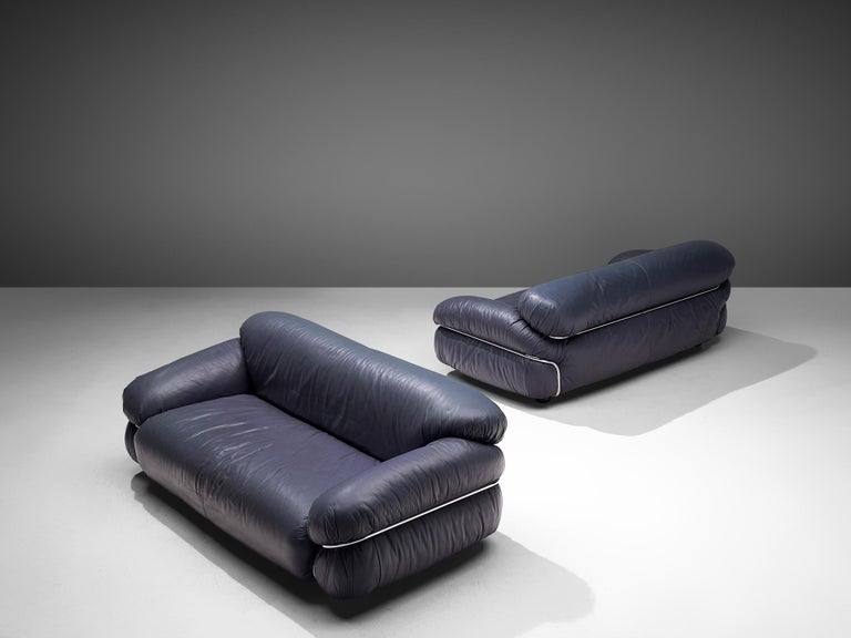 Gianfranco Frattini for Cassina, pair of 'Sesann' sofa, dark blue leather and chrome plated steel, Italy, 1969  These postmodern sofas are designed by Gianfranco Frattini. The 'Sesann' works from the idea of informal sitting where everything has a