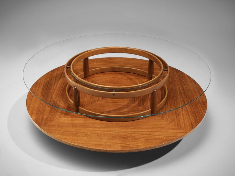 Gianfranco Frattini for Cassina, round coffee table, walnut, glass, Italy, 1950s  Beautiful coffee table in glass and walnut by Italian designer Gianfranco Frattini. This table has an interesting design. A round top in glass exposes the round