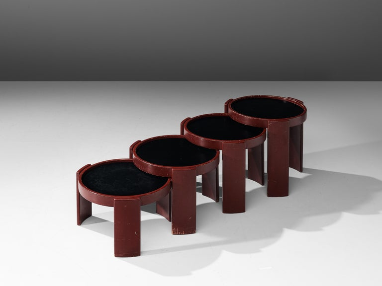 Gianfranco Frattini for Cassina, set of four nesting tables model 780/781, red lacquered wood, Italy, 1968  Gianfranco Frattini designed the 780 for Cassina in 1968. The set of four round nesting tables has different sizes. Three slat legs lift up