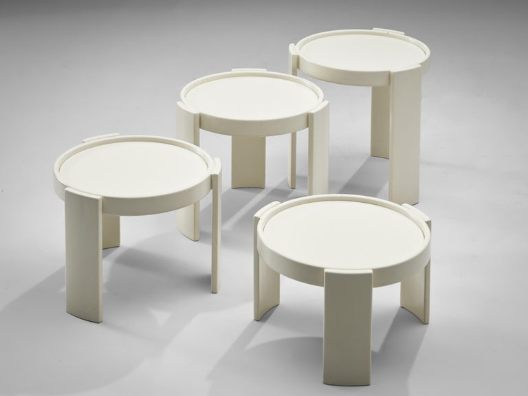 Gianfranco Frattini for Cassina, nesting tables, white lacquered wood, Italy, 1960s  Nesting tables model 780 consists of four pieces, designed by Gianfranco Frattini for Cassina. All the tables are executed in white lacquered wood, have a round