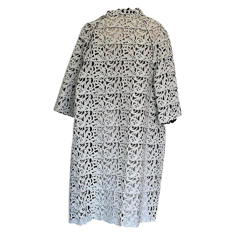 Very chic overcoat by Gianluca Capannolo Beautiful cut & fit Polyamide (80%) and elasthane (20%) Black and white Double face Floral pattern 3/4 Sleeve Total length cm 109 (42.9 inches) Brand new with tags Worldwide express shipping included in the