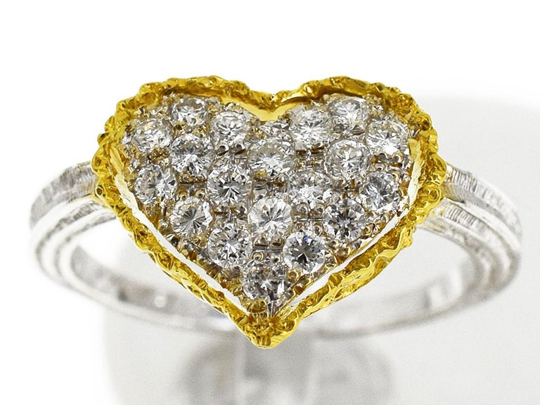 Brand:GIANMARIA BUCCELLATI Retail Price :US 6,500.00 Name:Heart design Diamonds Ring Material :19P Diamond (D0.37cts), K18 750 YG WG Yellow Gold White Gold Ref. :#M101 Comes with:Our original box,certificate Ring size:British & Australian:K /   US &