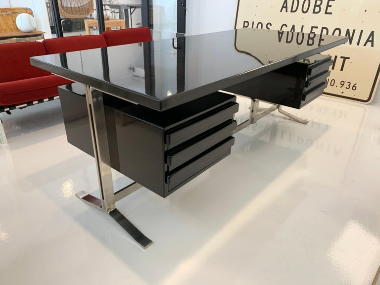 Stunning platform desk by Gianni Moscatelli for Formanova. Made in Italy, in the 1960s. Wood is Ebony Macassar. Brushed steel frame in great vintage condition. Wood newly refinished in smokey grey/brown to show wood grain. Finished in multiple coats
